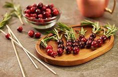 Looking for an easy way to make your cocktails stand out this holiday season? Try these festive Cranberry Rosemary Garnishes!