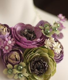 Olive and Plum ranunculus. What's amazing is that it's a necklace and it's made out of paper! Gorgeousness.