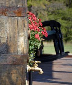 Rainwater harvesting using reclaimed whiskey oak barrels | Stonemore...close up shot of spout/faucet...