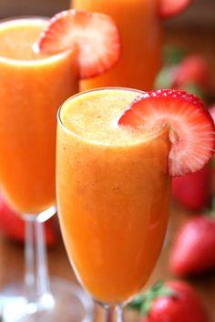 Strawberry Mango Mimosas  - CountryLiving.com