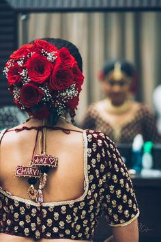 Beautiful bun and quirky blouse tussles with bride and groom name - Bridal bun, hairstyles, bridal blouse, tussles, blouse design. Bridal hairstyles