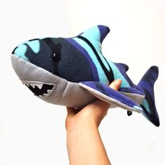 This cold-blooded cuddle buddy. | 23 Dangerously Adorable Things For Anyone Who Loves Sharks