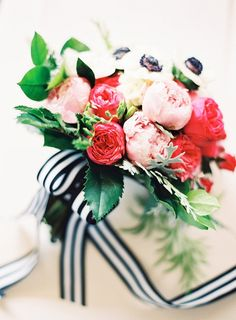 Blush and Pink Bouquet with Black and White Striped Ribbons | Jordan Brittley Photography | http://heyweddinglady.com/whimsical-kate-spade-wedding-black-tie/
