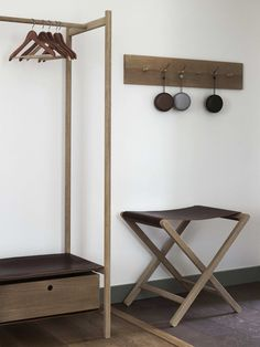 Halleröd designed a custom oak peg rail, standing clothes rack, and folding luggage rack for guest room entryways.