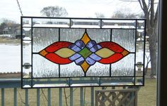 Victorian style beveled stained glass panel window Red amber purple stained glass window panel window hanging. $119.00, via Etsy.