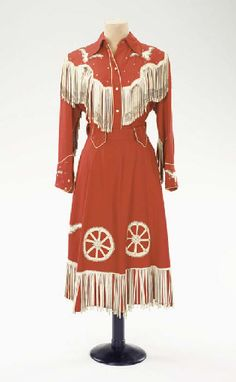 Pasty Cline dress- Wagon wheels and steer heads! The steer heads have little rhinestone eyes-I think her mom made all her clothes.