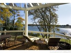 Cottage style house with all the goodies on a quiet Lake Minnetonka bay. Sun-filled, sand beach, incredible walkout amusement room and home theater. | 1000 Wildhurst Trail, Orono, MN 55364