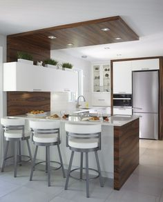 White countertops and cabinets, with wood accents.