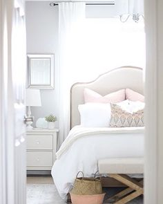White bedding with a little color. Headboard is nice too.