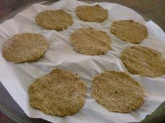 *1 cupFlaxseedMeal  (Golden has the best flavor)  *1 cup Water  *1 1/2 Tbs. seasoning (I use Popcorn seasoning - It's lowcarband comes in a variety of flavors such as Ranch & Garlic Parmesan)  *Parchment Paper