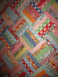 Jelly Roll Quilt :) so simple, but love the colors. and so rewarding when you sleep under when done