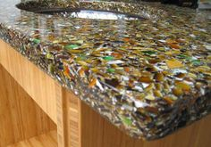A cool idea for glass counter top- glass and cement or resin base. Very cool and maybe a fun craft project!