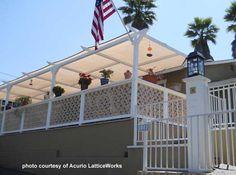 Lattice deck railings add privacy. front-porch-ideas-and-more.com