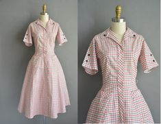 Vintage 1950s white cotton dress with a red and black plaid print throughout. The dress features an invisible front metal zipper for closure. Very flattering fitted bodice with bust darts and a nipped waist fit with a full skirt. ✂------ M E A S U R E M E N T S ------- best fit: medium bust: 38 waist: 28 hips: open fit total length: 45  tag/label: Kenrose material: cotton condition: excellent _______________________________  ☆ Layaway is available for this item! ☆ Express shipping is ava...