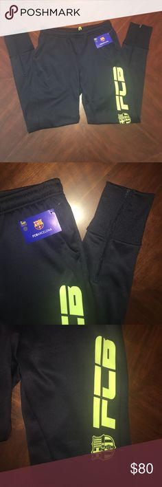 NWT FC Barcelona Joggers NWT, dark grey, almost black joggers, stretchy and comfy. Fleece lined, zippers up the back of the legs. Has FCB and the logo up one leg. Hard to find these, RARE! Could fit a women's XS-small. •NOT NIKE• Nike Pants Sweatpants & Joggers