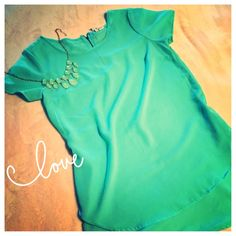 REDUCEDTurquoise Blouse High low short sleeve blouse in beautiful sheer aqua color. In very good condition! Tops Blouses