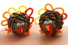 This fun and easy Thanksgiving craft is the perfect thing for kids to do while waiting for dinner at your Thanksgiving party with a few inexpensive materials and some pinecones from the back yard.