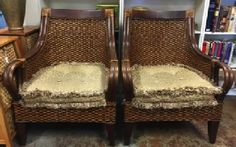 "Pair of rattan basket chairs sot stylish lounging in your great room. Greek ""klismos"" form made from bamboo and woven split cane. 29""x 26"" x 36"" SOLD"