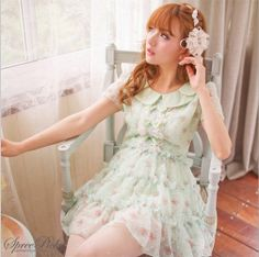 A very lovely mint green chiffon dress with the collar and the flower to add a nice feminine touch.