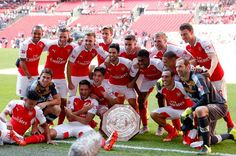 Champions: Arsenal players celebrate with the trophy
