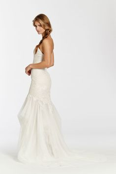 Ivory over Cashmere English Net fit n flare bridal gown. Criss-cross draped elongated bodice with delicate hand-placed lace appliques throughout, and sheer layered skirt. Bridal Gowns, Wedding Dresses from Ti Adora by Alvina Valenta - JLM Couture - Bridal Style 7509 by JLM Couture, Inc.