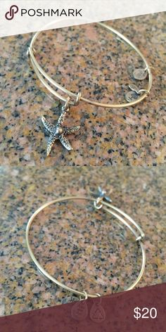 Alex & Ani Gold Bangle Alex & Ani gold bangle with starfish charm **ONLY WORN ONCE-- PERFECT CONDITION** Alex & Ani Jewelry Bracelets