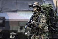Soldiers of a Long Range Reconnaissance Patrol of the German Armed Forces march during an exercise prior the arrival of German Defense Minister Ursula von der Leyen at the Bundeswehr training ground on October 10, 2014 near Bergen, Germany.