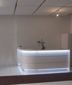 curved L rounded glossy white reception desk with LED lights