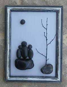 """Pebble Art (Family of Three in Silhouette sitting on rock under a tree and moon) set on a gray background in vintage rustic 6x8 """"open"""" frame"""