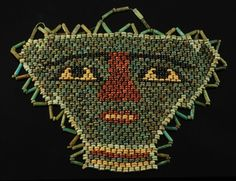 Egyptian Beaded Mummy Mask, in variegated shades of blue and green with detailing in black, red and yellow; border of cylindrical form beads. Grain Of Sand, Palm Of Your Hand, Shades Of Blue, Antique Furniture, Egyptian, Period, Fine Jewelry, Objects, Beads