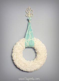 wreath made from the book Made it Sew Modern: http://www.amazon.com/Make-It-Sew-Modern-Texture/dp/1604680598/ref=sr_1_1?ie=UTF8&qid=1379013172&sr=8-1&keywords=make+it+sew+modern