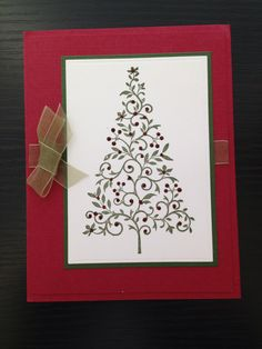 A Christmas Card I made with a stamp that I believe I purchased from Michaels a few years ago.....just a little bit of stickles on the berries and all is right with my world!!