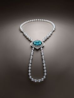 A 54.30 carat tourmaline from Mozambique is set in Louis Vuitton's one of a kind Conquêtes necklace that also features pearls and diamonds.