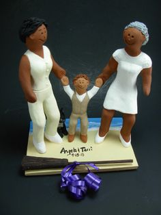 Gay African American Bride's Jump Broom Wedding Cake Topper, African American Lesbians Wedding Cake Topper, black lesbians wedding statue  These were commissioned for gay brides marriages and wedding ceremonies involving two women.... be inspired by these examples and let us know what details would make the most memorable Lesbian wedding keepsake for you and yours!  $235 #magicmud 1 800 231 9814 www.magicmud.com