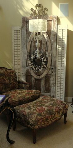 Great vignette with old door, frame, shutters, and sconce.