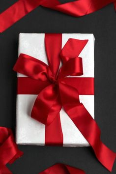 red silk ribbon decorated christmas gift