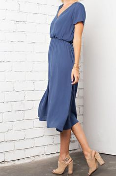 Quite possibly the best midi dress ever! It has an elastic waist band so you can easily just pull it over your head -- NO ZIPPER HEADACHE! Short sleeve length gives perfect coverage for a more flatter