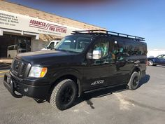 Black out Nissan, 4x4 done by Advanced 4x4 in Salt Lake City, UT.  Aluminess roof rack and Advanced 4x4 rear door ladder.  #advancedvans Nissan Vans, Nissan 4x4, 4x4 Van Conversion, Camper Van Life, Bug Out Vehicle, Salt Lake City Ut, Expedition Vehicle, Four Wheel Drive, 4x4 Trucks
