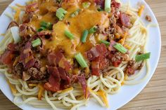 Cowboy Spaghetti by Rachael Ray. This is one of my favorite dishes! Whats not to like? Bacon, cheese and ground beef? That's whats up!