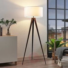 Buy Benik tripod floor lamp, white lampshade, walnut ✓Top-rated service ✓Comfortable & secure payment Years of experience ✓Order now! Tripod Floor Lamps, Modern Tripod Floor Lamp, Lamp, Dark Walnut Finish, White Lamp Shade, Flooring, Floor Lamp Design, Fabric Lampshade, Living Room Designs