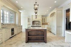 I like this backsplash (subway tile)Traditional Antique White Kitchen Cabinets  (Kitchen-Design-Ideas.org)