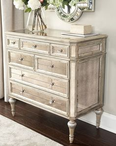 "Dresden Mirrored Chest Chest crafted of wood and mirrored glass. Antiqued-cream finish with silvery accents. Seven drawers. 38""W x 19""D x 37""T. Imported. Boxed weight, approximately 150 lbs. Dresden Mirrored Chest Compare At: $1,709.00 Special Value: $1,099.00"