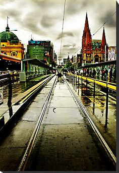 Melbourne tram pulls away outside Flinders Street Station Melbourne Tram, Places In Melbourne, Melbourne Australia, Melbourne Weather, Australia Photos, Oh The Places You'll Go, Places To Travel, Places To Visit, Melbourne Victoria
