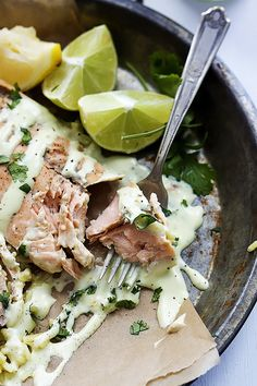 Tender pink salmon baked in foil, then drizzled with zesty creamy avocado sauce!