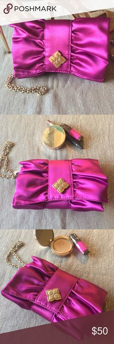 """BCBG MAXAZRIA SATIN CLUTCH BCBG maxazria magenta clutch 👛 with gold strap.  Never been used in like new condition. Looks like a beautiful flower.  6"""" W X 4"""" H x 3"""" deep. Retail price was $65 BCBGMaxAzria Bags Clutches & Wristlets"""