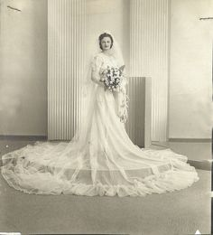 Detroit/Hamtramck wedding, c.1930s-1940.  This looks very similar to my Mom's dress, she bought it 'off the rack' for $90.