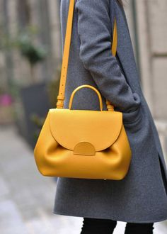 "Edition - Monochrome Yellow Undeniably feminine for its sensual curves, ""Number One"" is Polène's signature handbag. Designed as a day..."
