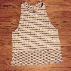 Black and white tank top Black and white tank top with unique pattern - small button on the back - never worn before - bundle to save!!  Tops Tank Tops