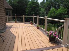 Beautiful deck design uses a two toned color scheme for the planks as well as al. Beautiful deck d Pallet Pergola, Iron Pergola, Pergola Swing, Deck With Pergola, Pergola Patio, Black Pergola, Attached Pergola, Pergola Cover, Deck Stain Colors