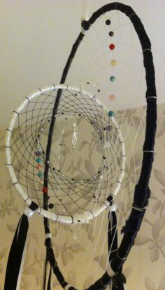 #Yin_Yang #Dream_Catcher by #RobynDMartland at #Coyotes_Realm  With Chakra Gemstone Beads : - Onyx, Garnet, Carnelian, Citrine, Green Moss Agate, Cherry Quartz, Turquoise, Amethyst, Opalite and Dragon Charm. Swan, Goose and Raven Feathers.  This is a custom made order for one of my students.